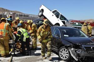 Firefighting paramedics remove an injured motorist after an accident Tuesday June 26, 2012 (AP Photo/Rick McClure)